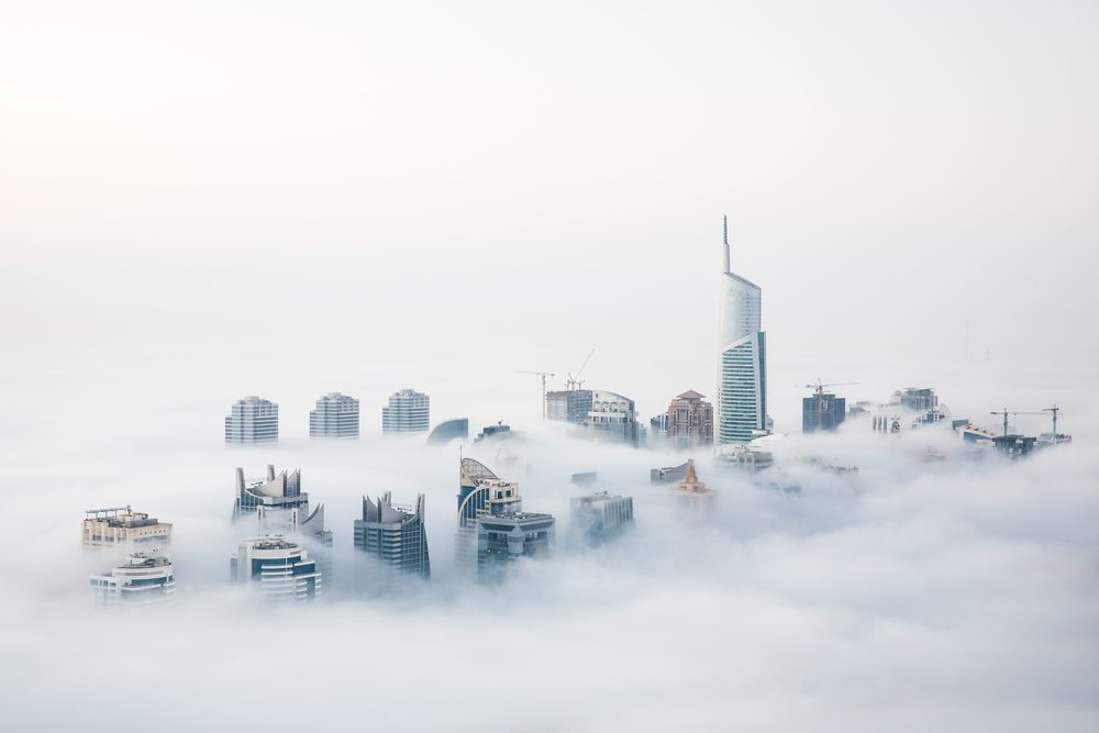 When cold desert air meets warm ocean air at the start of the winter, Dubai witnesses a unique sight of world's highest skyscrapers drowning in fog. Dubai, UAE.