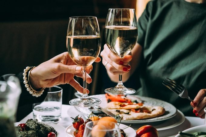 toast glasses wine dinner friends