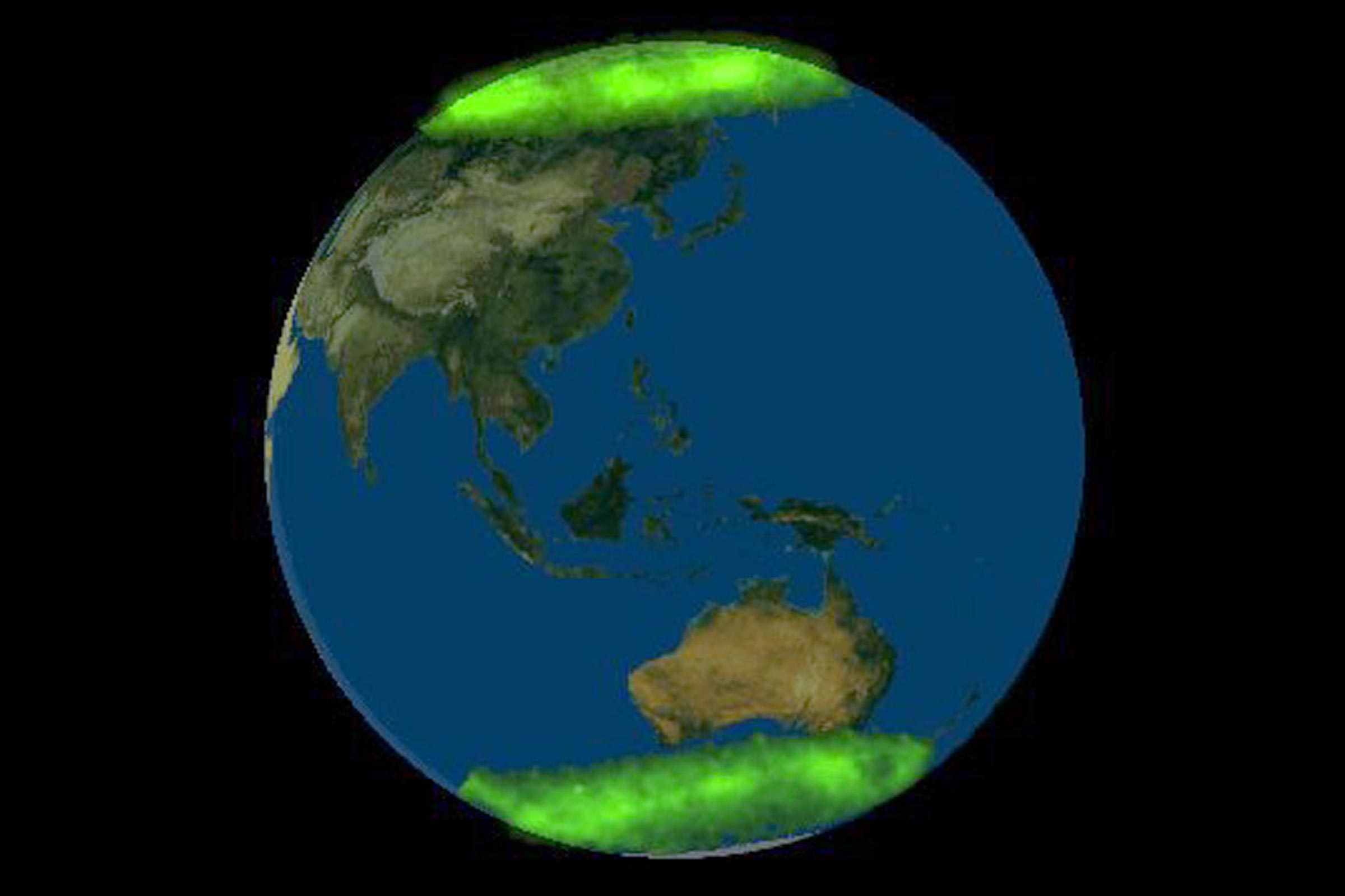 FIRST PHOTOGRAPH OF THE EARTH SHOWING BOTH AURORAS