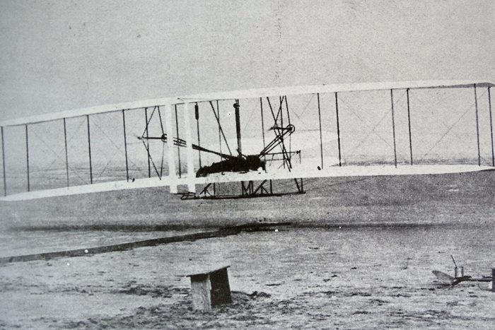 The 'Flyer' makes a perfect take-off. Orville Wright, arranged that this photograph would be taken of the first controlled, sustained and powered heavier-than-air flight. 17th December, 1903.