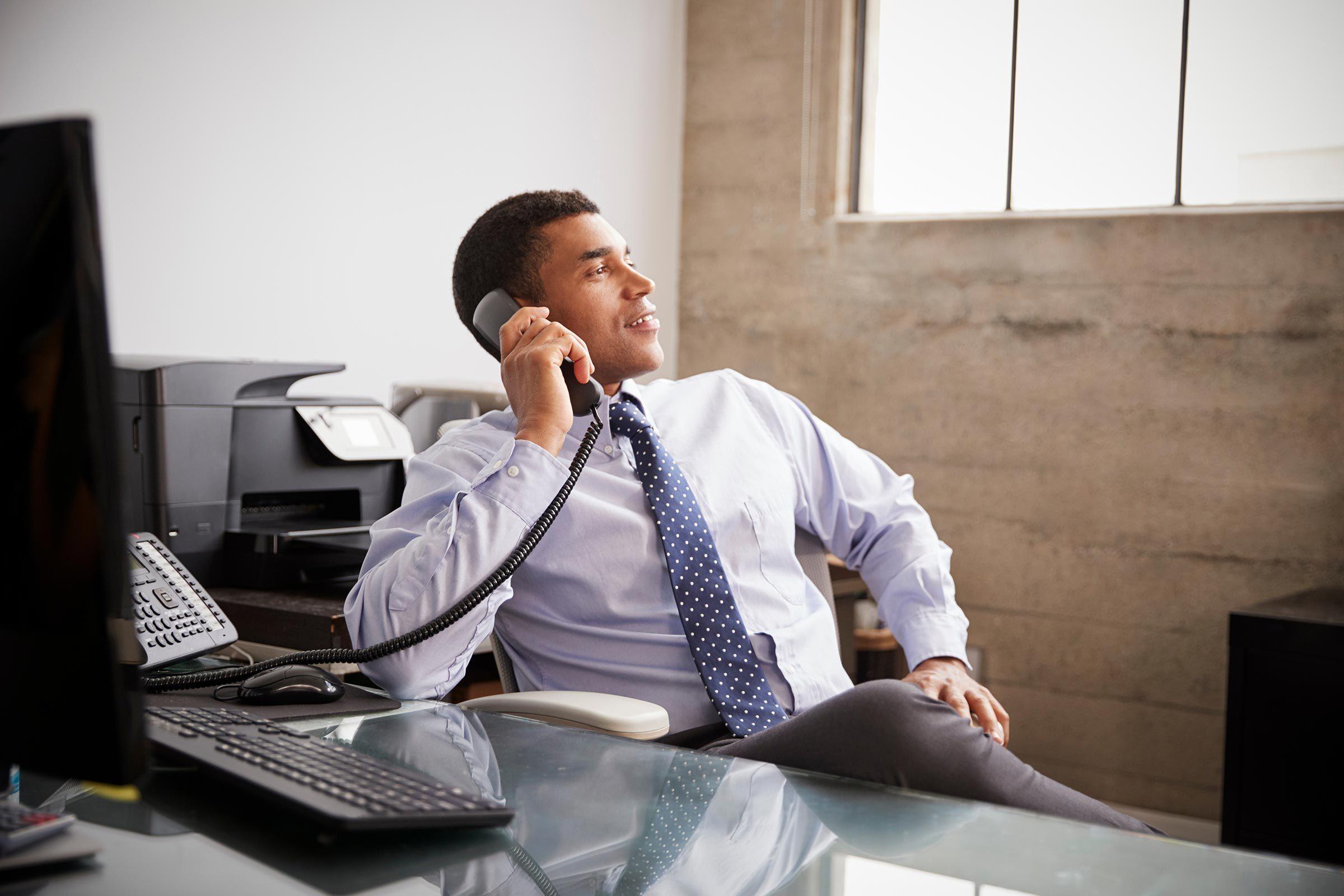 man phone call office