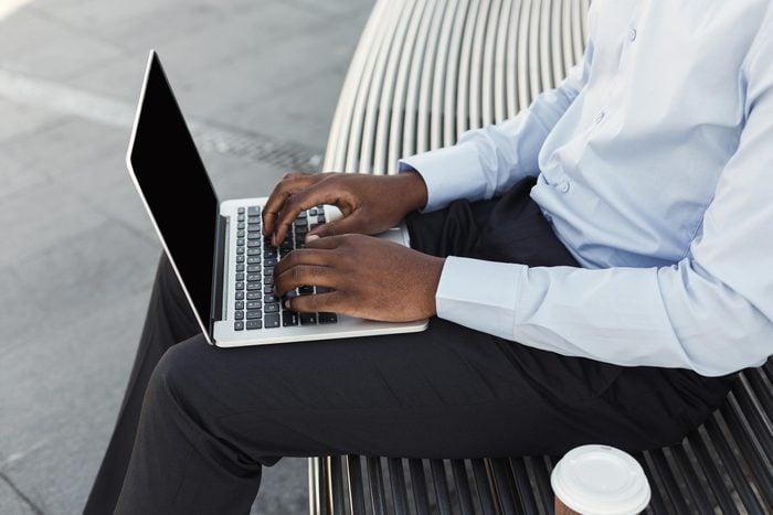 man typing laptop computer