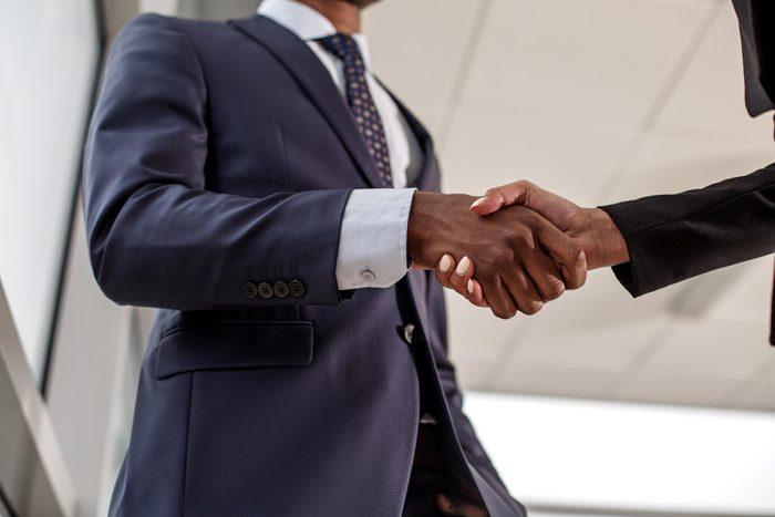 coworkers handshake