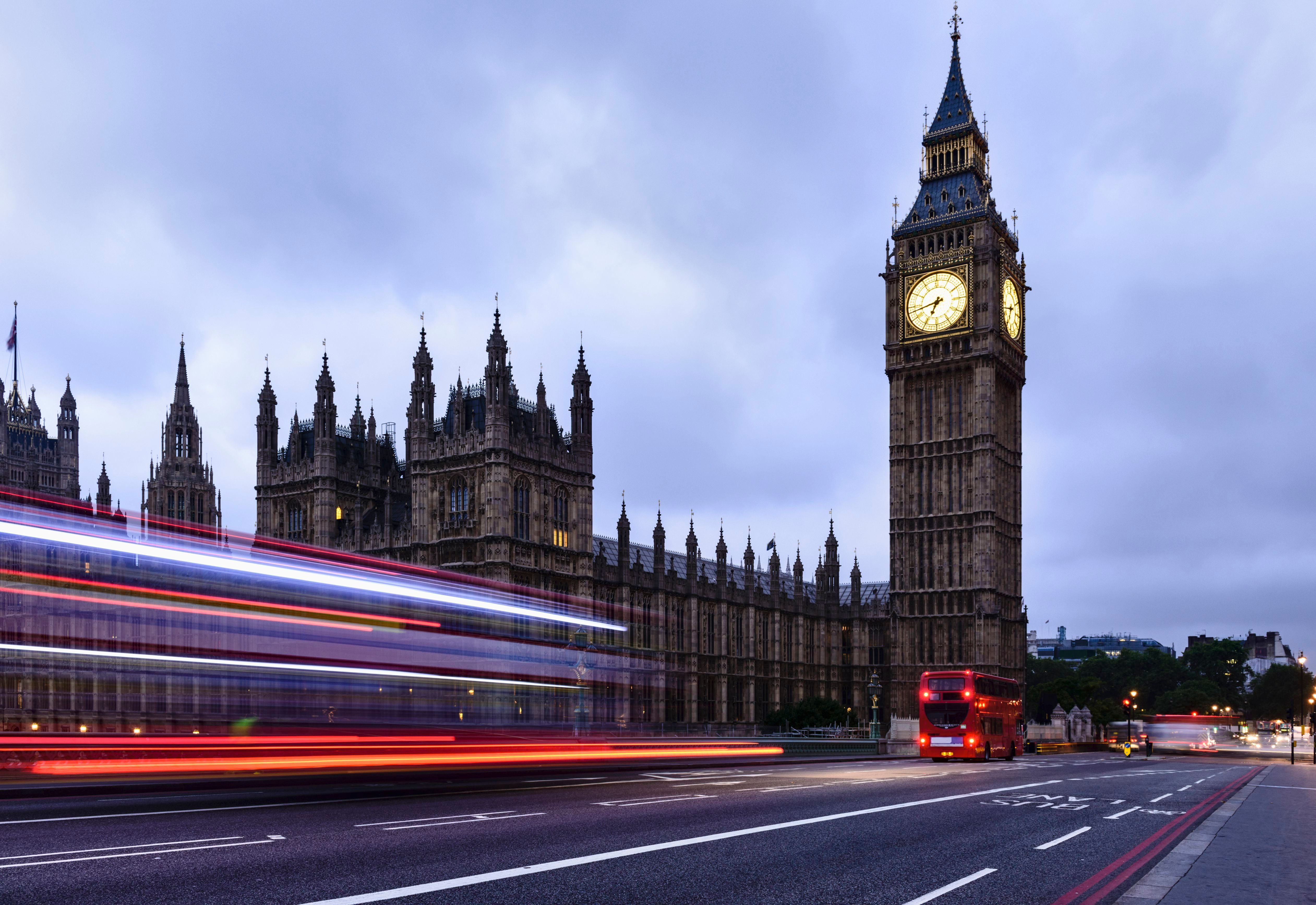Time lapse view of bus passing Houses of Parliament