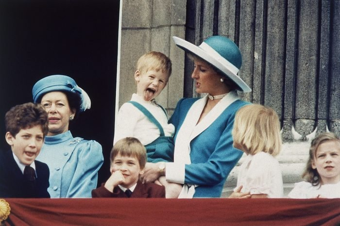 Britain's Prince Harry sticks out his tongue for the cameras on the balcony of Buckingham Palace