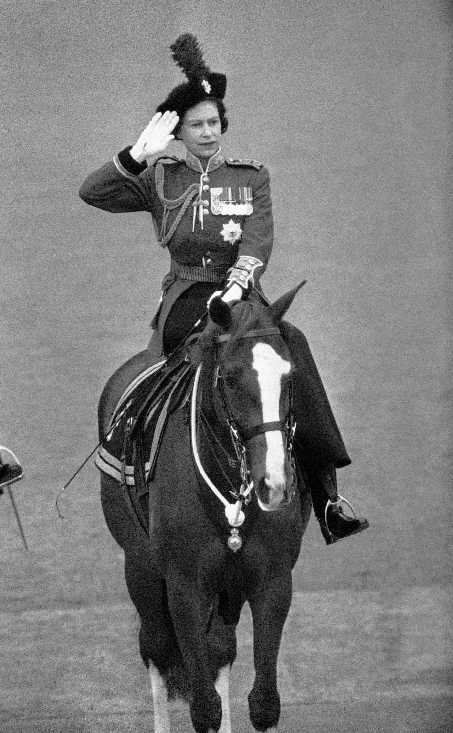 Queen Elizabeth II takes the salute at the traditional Trooping the Color