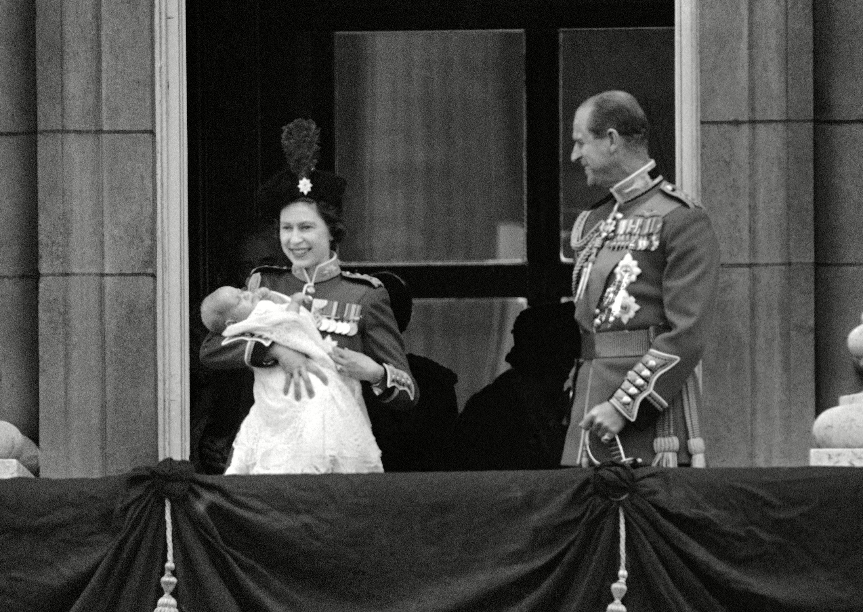 Queen Elizabeth II holds up 12-week-old son Prince Edward