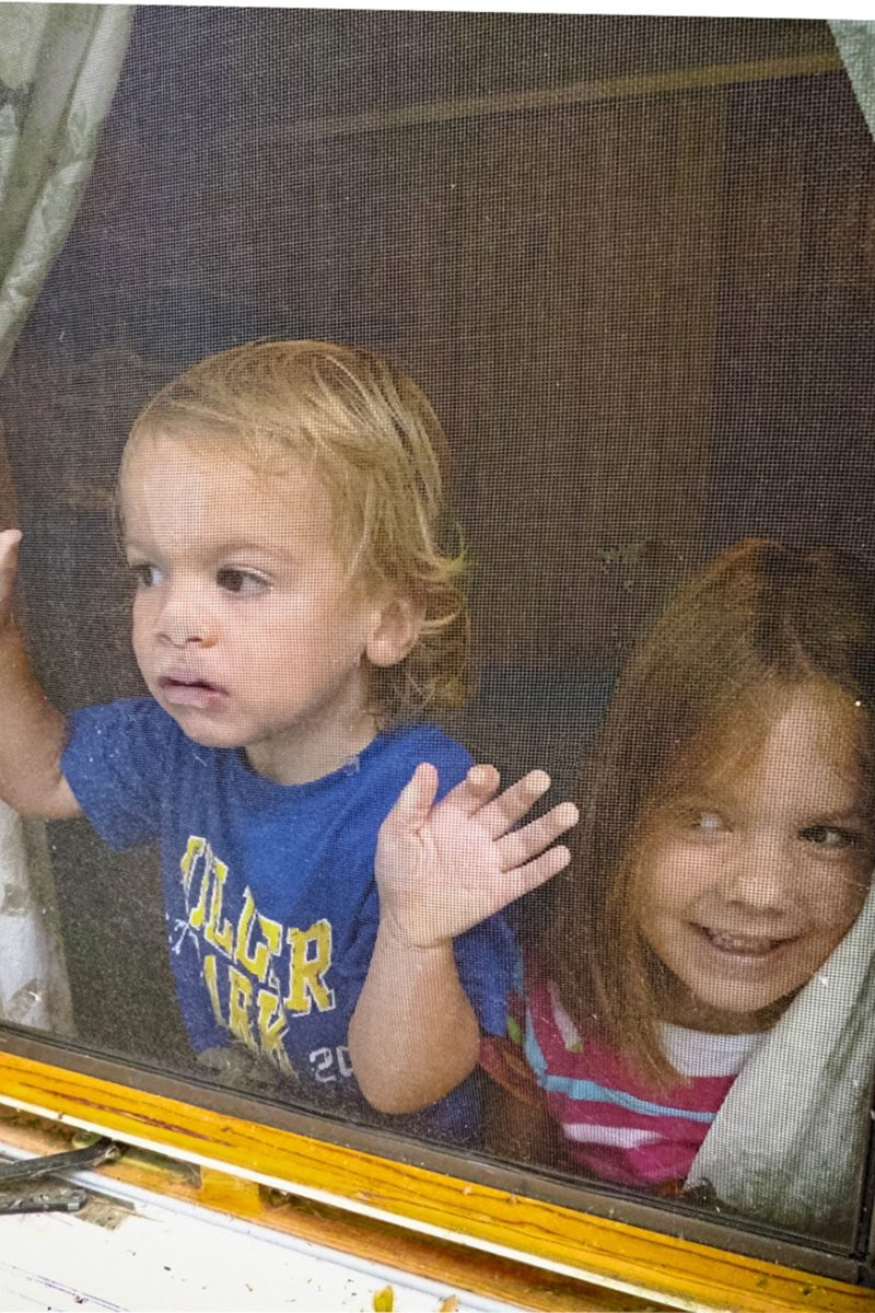 kids pressed up to window screen