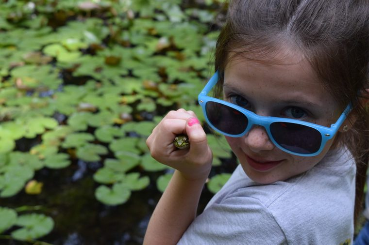 daughter holding frog