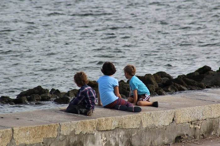 little boys loooking at bay