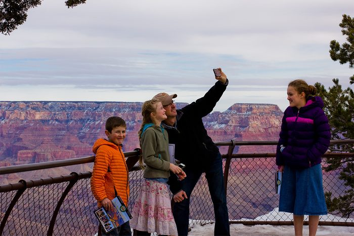 family in grand canyon selfie