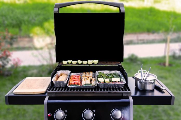 Gas Grill With Vegetables And Sausages