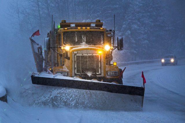 snow plow driving near a plow