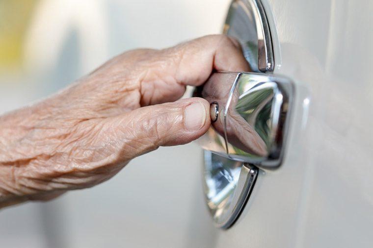 elderly woman hand opening car door