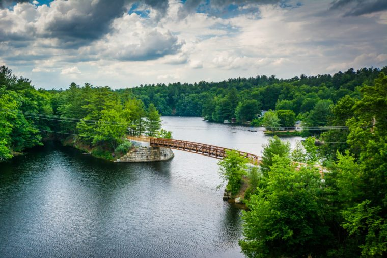 View of wooden bridge over the Piscataquog River, from the Pinard Street Bridge in Manchester, New Hampshire.