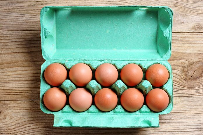 dozen brown eggs in carton