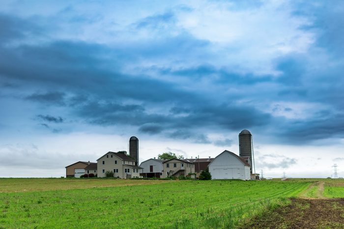 Simple Amish farm house with silos in rural Pennsylvania, Lancaster County, PA, USA