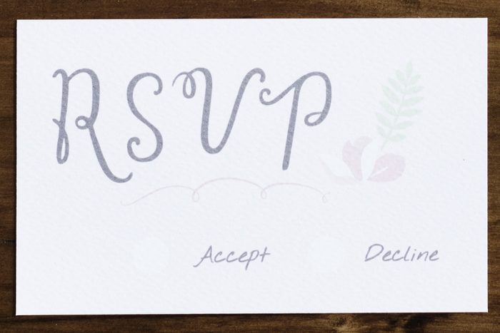 Wedding Invitation Cards Papers Laying on Table RSVP
