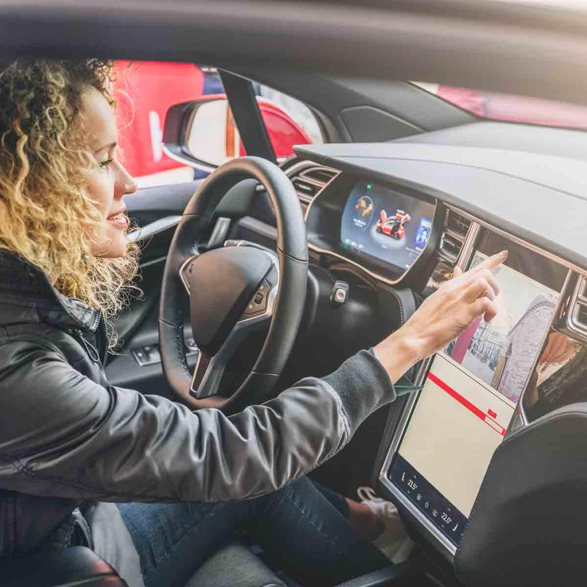 Woman-using-car-computer