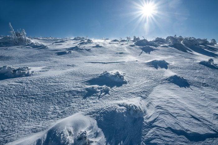 Antarctica ice desert landscape. Snowy hills on a frozen plain