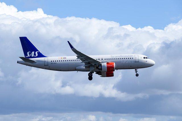 Arlanda, Stockholm, Sweden - April 27, 2018: Scandinavian Airlines, SAS, Airbus A320-251N fly by and landing at Stockholm Arlanda Airport / ARN. Jet aircraft / plane.