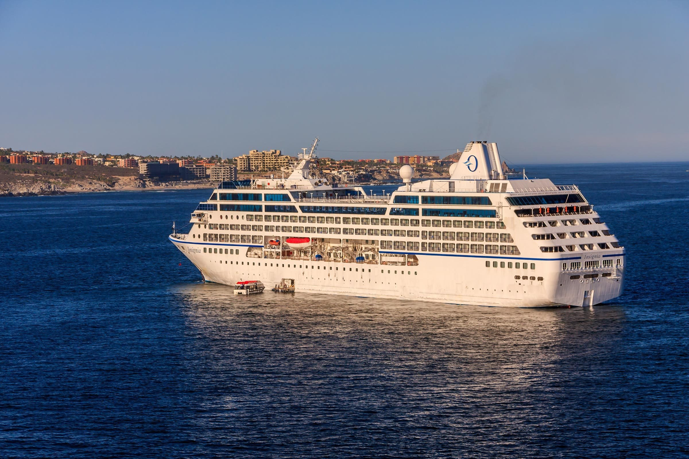 Cabo San Lucas, Mexico - June 19, 2018 - MS Insignia cruise ship was at anchor in Cabo San Lucas, tendering it's passengers to the island. MS Insignia belongs to Oceania Cruise Line