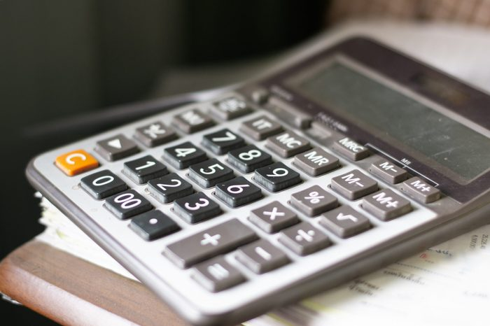 The calculator is placed on the document stack.