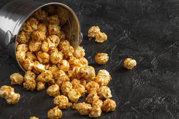 Loose popcorn on a dark background horizontally
