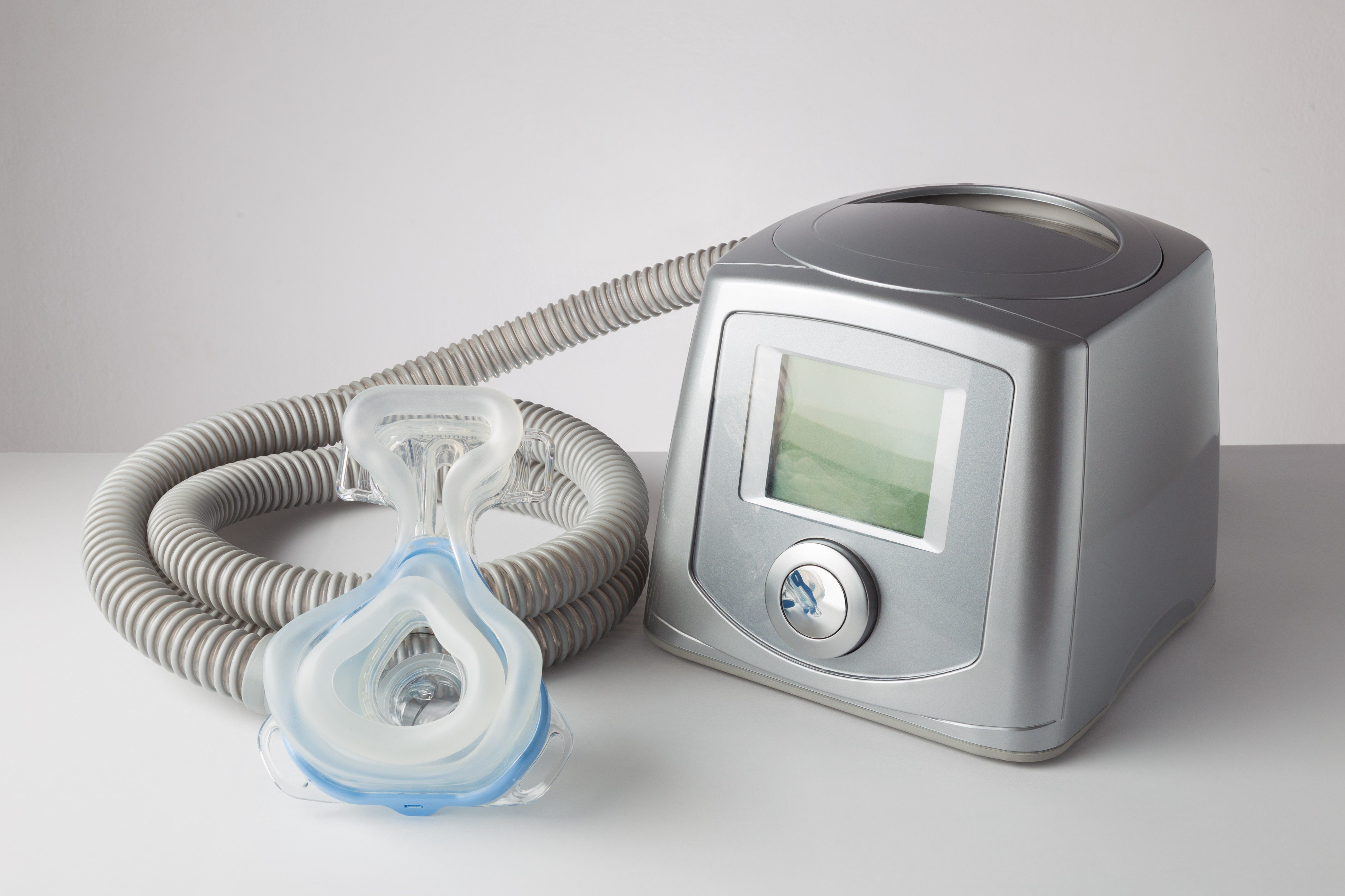 CPAP machine with mask and hose, for people with sleep apnea, respiratory, or breathing disorder