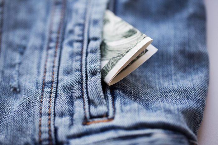 finance and currency concept - dollar money in pocket of denim jacket