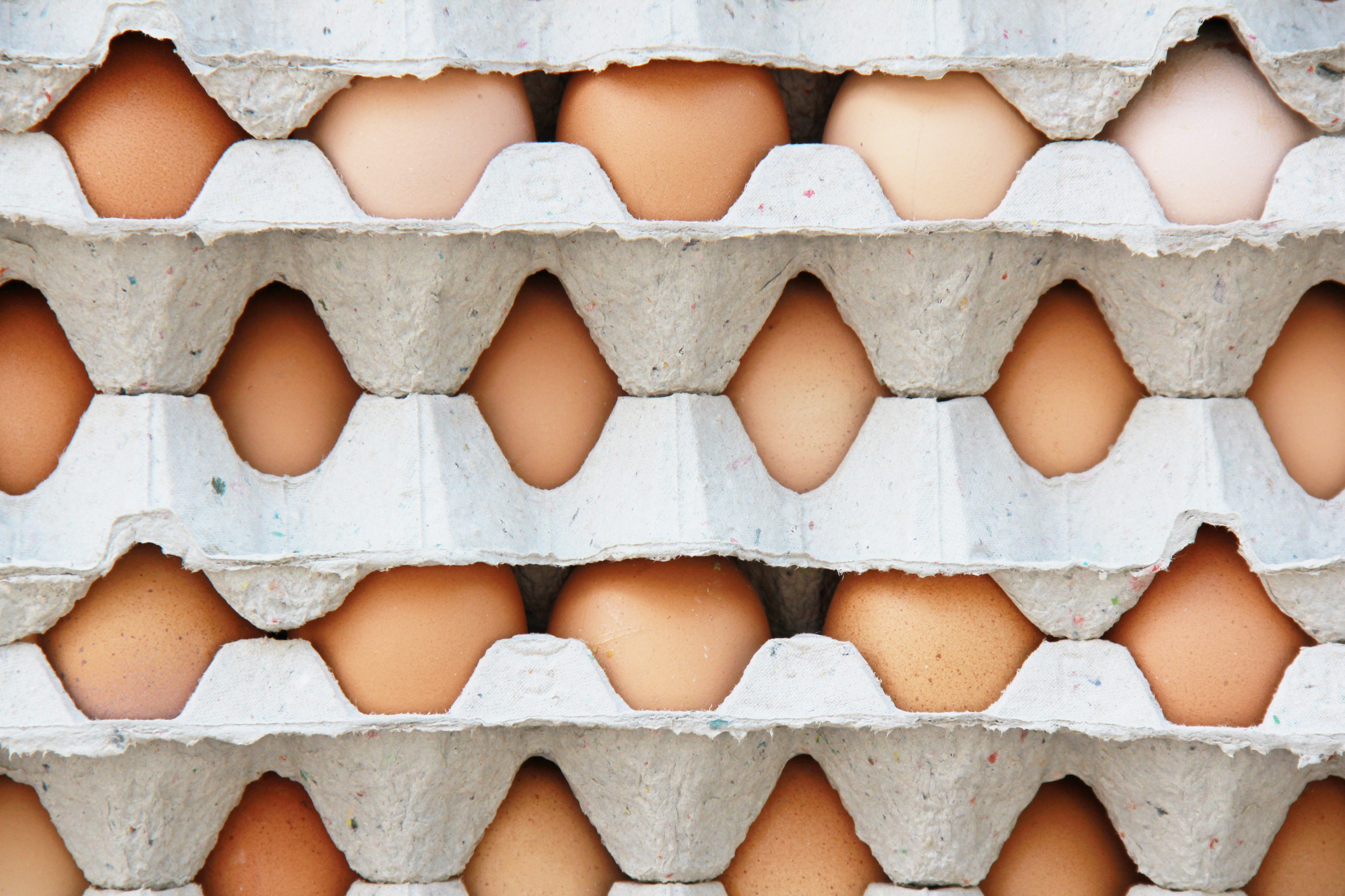 background of a pattern of packs of egg