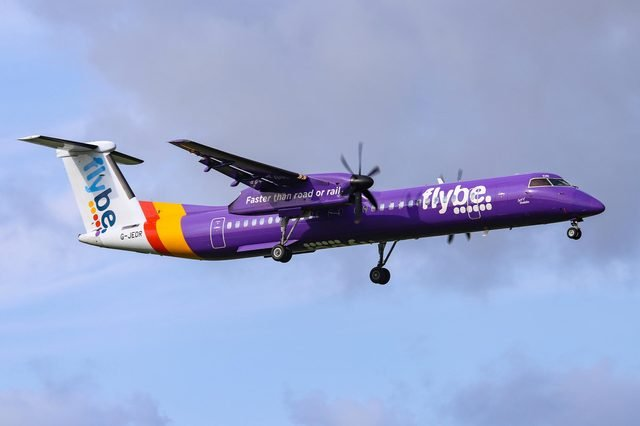 Flybe landing in Amsterdam. Aircraft type is De Havilland Canada DHC-8-400 with registration G-JEDR and name Spirit of Dublin. Amsterdam, Netherlands - August 30, 2018