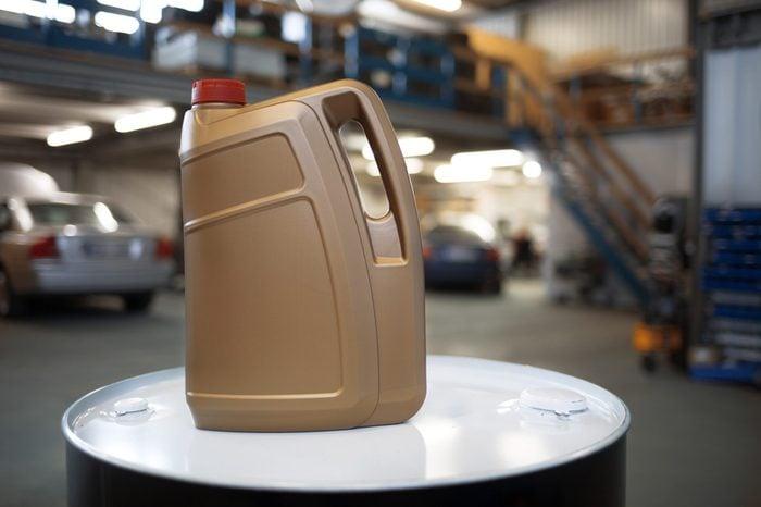 Plastic container for motor oil in car repair shop