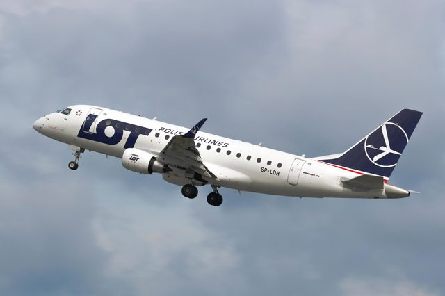 GDANSK, POLAND - SEPTEMBER 4, 2018: Polish Airlines PLL LOT branded Embraer 170 airplane flying from Lech Walesa International Airport in Gdansk in cloudy sky.