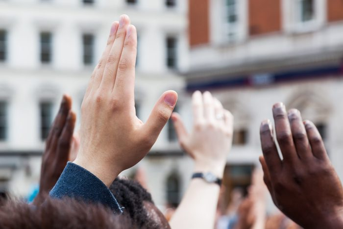 raised hands in a crowd of people