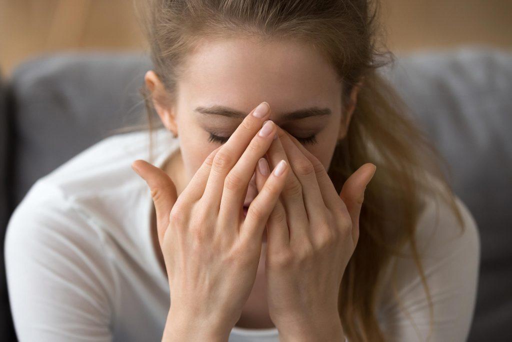 woman migraine headache pain