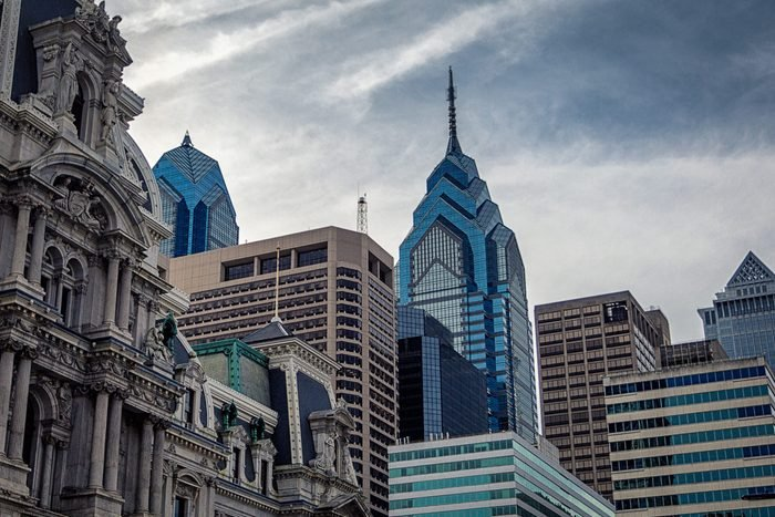 Top view of Philadelphia modern skyscrapers and historical building of City Hall