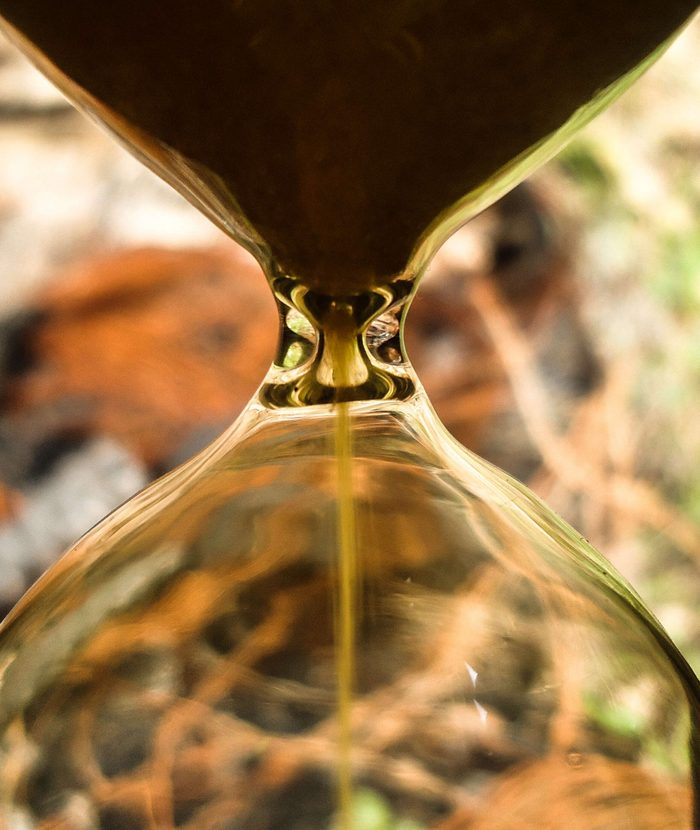 Approximate image of an hourglass with yellow sand, with blurred background. This image can be used as a texture for advertisements that use the time theme. photo taken in Soledade, Paraíba, Brazil.