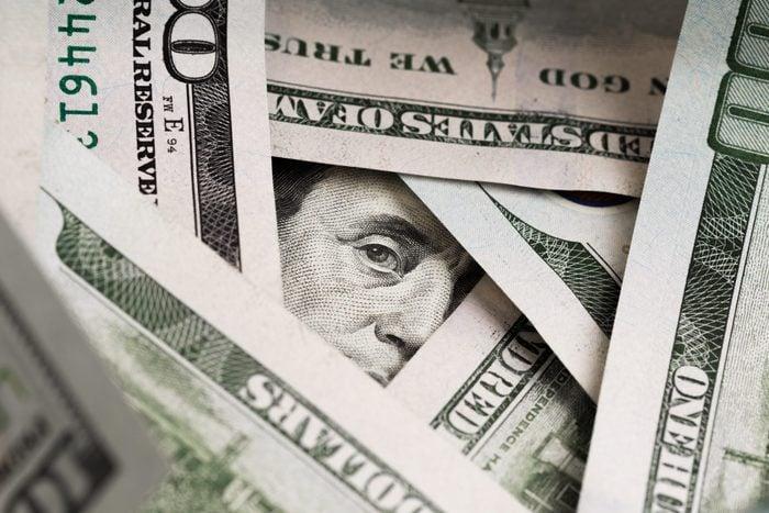 Benjamin Franklin's look on a hundred dollar bill. Benjamin Franklin portrait macro usa dollar banknote or bill