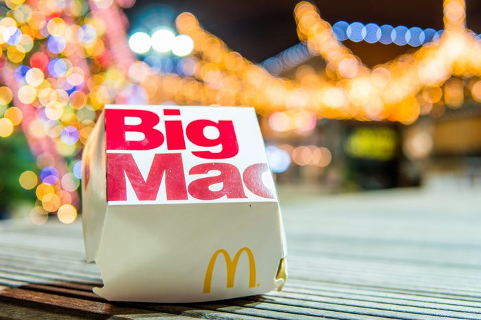 Lodz, Poland, January 5, 2018 McDonald's Big Mac night, Christmas tree in background, McDonald's was founded in 1940 as restaurant operated by Richard and Maurice McDonald, in USA