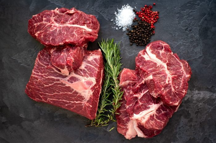 Fresh Beef shoulder Blade on the stone table - Top Blade steaks cut from a whole piece