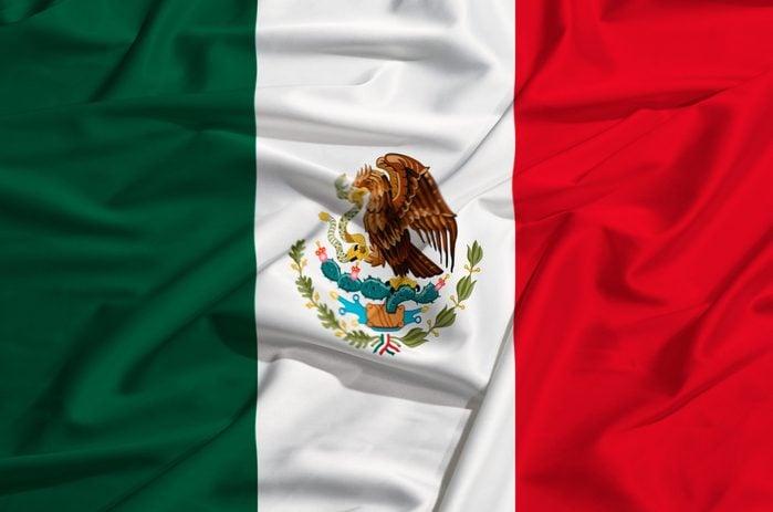 Mexico flag on a silk drape waving