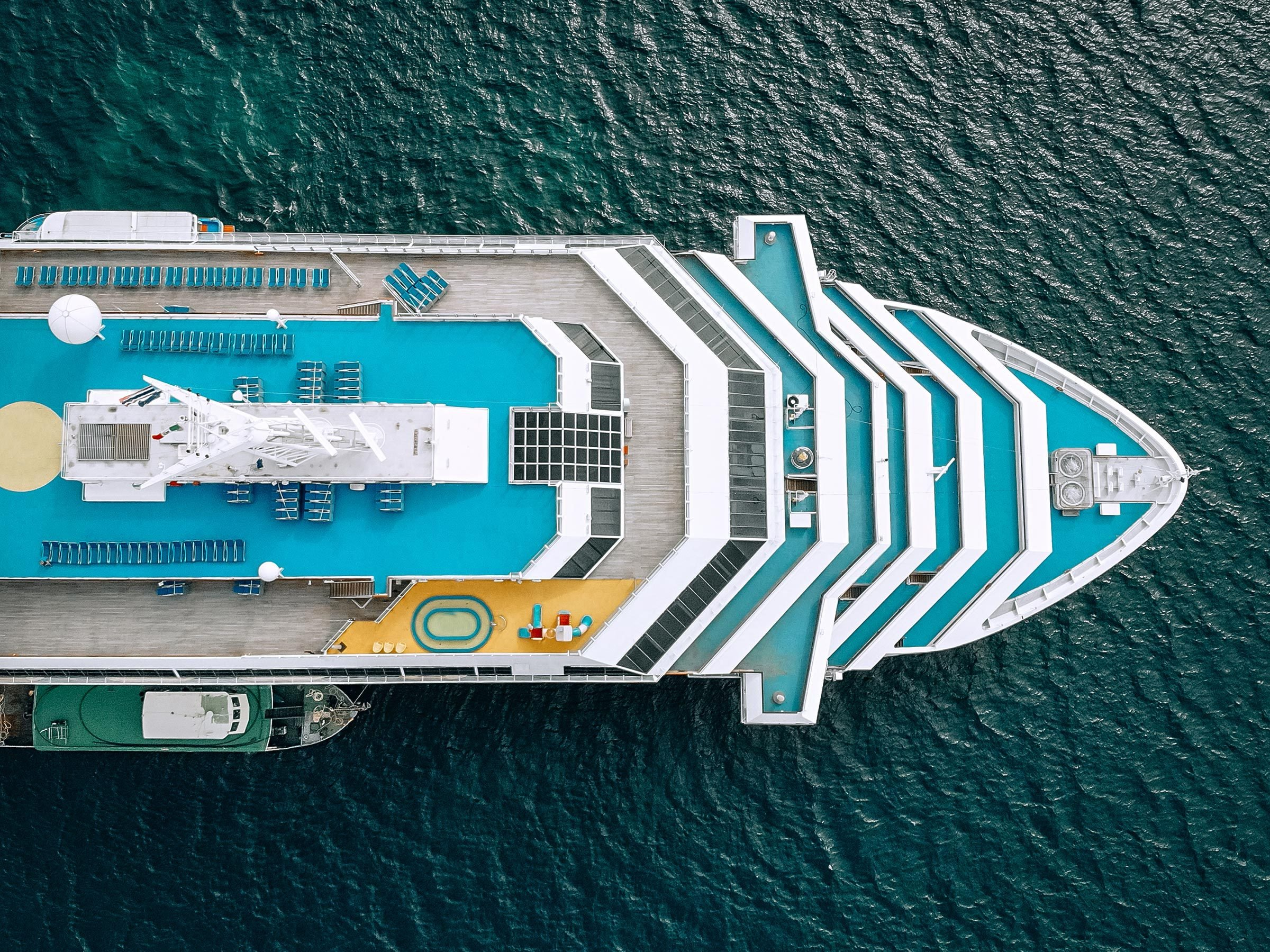 Nose of the blue cruise ship in the sea - top view. The Andaman sea - Aerial image. Beautiful sea landscape