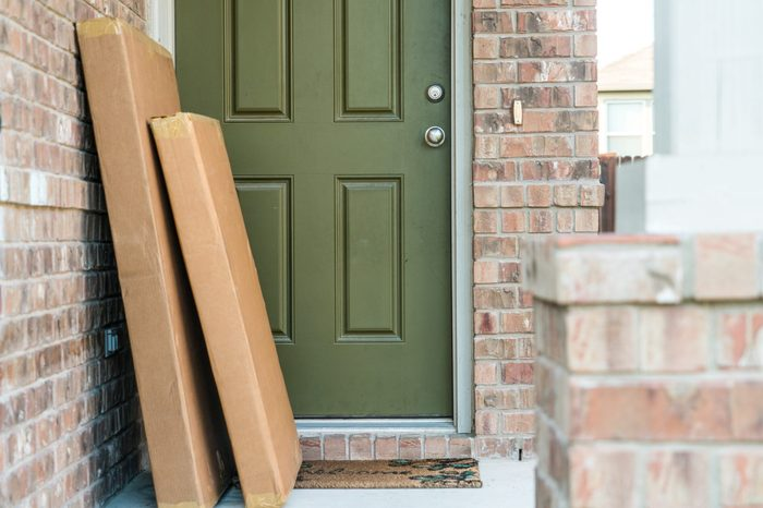 Large packages in cardboard boxes waiting for home owner to come home from work