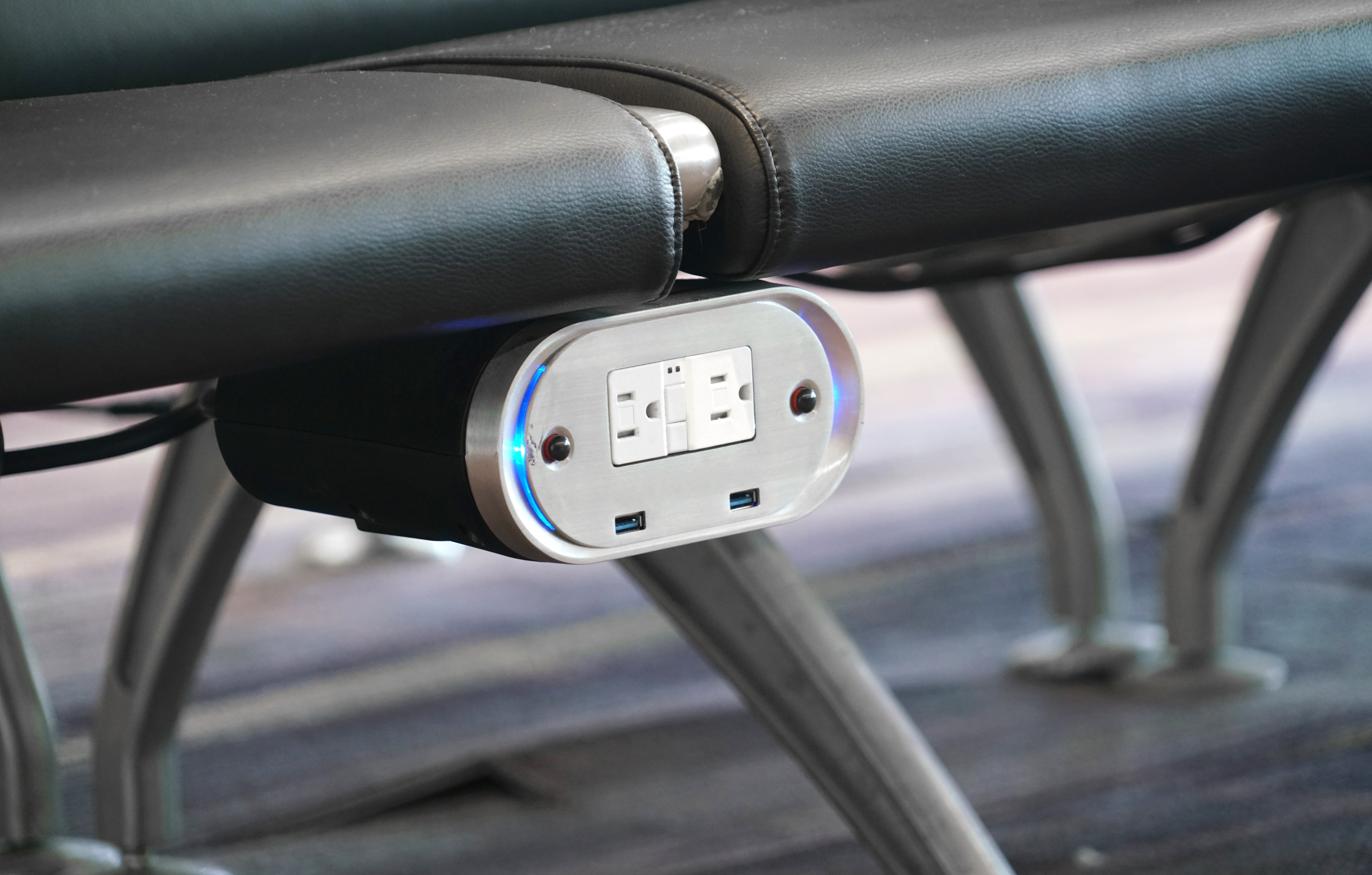 Close up on charger outlet under seat in the airport