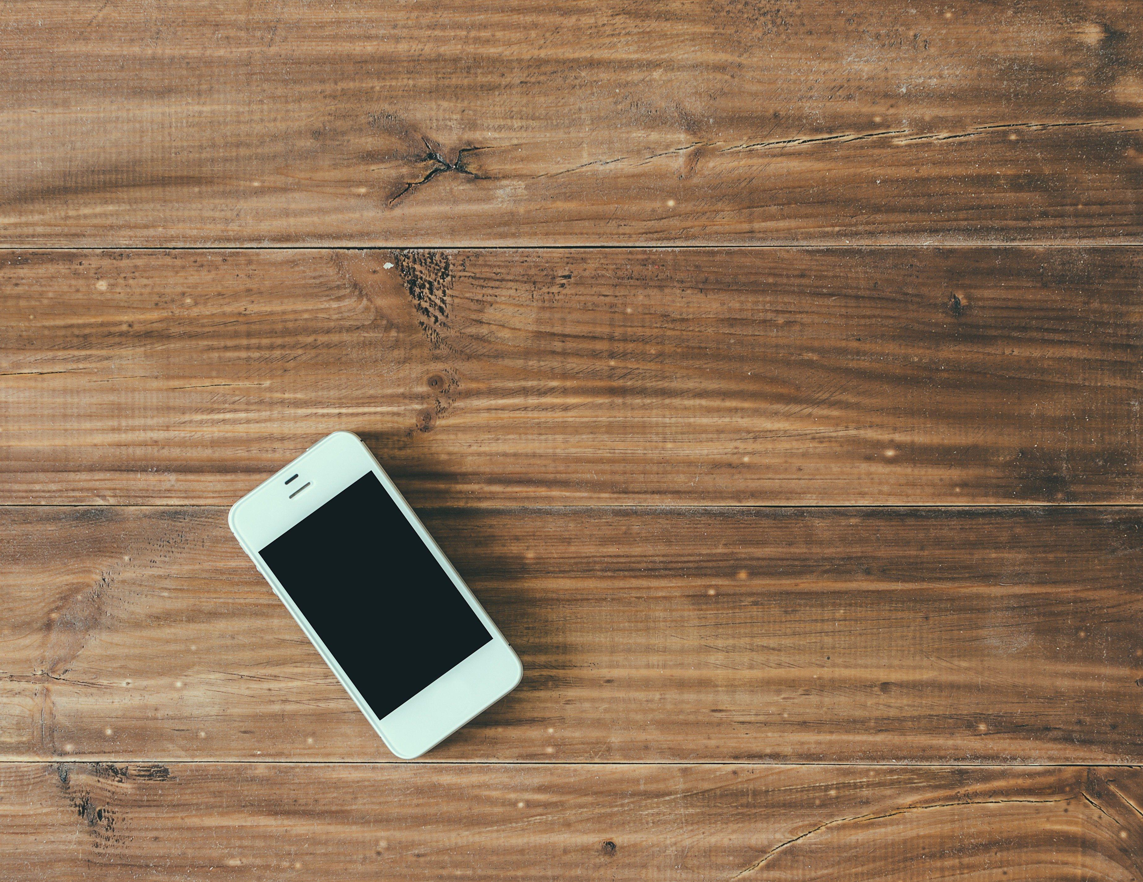 White phone on wood vintage office table