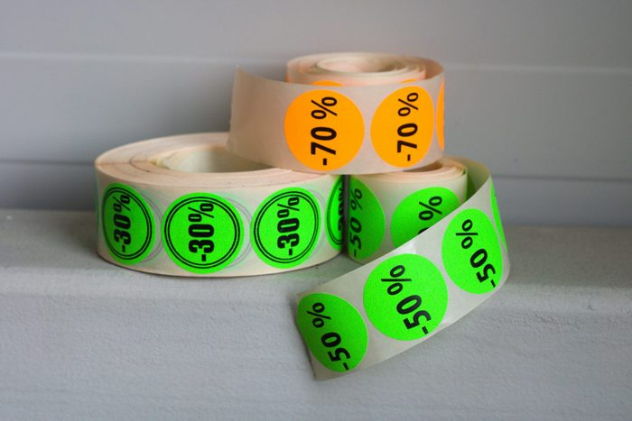 Printed colorfull sticker rolls on gray background.