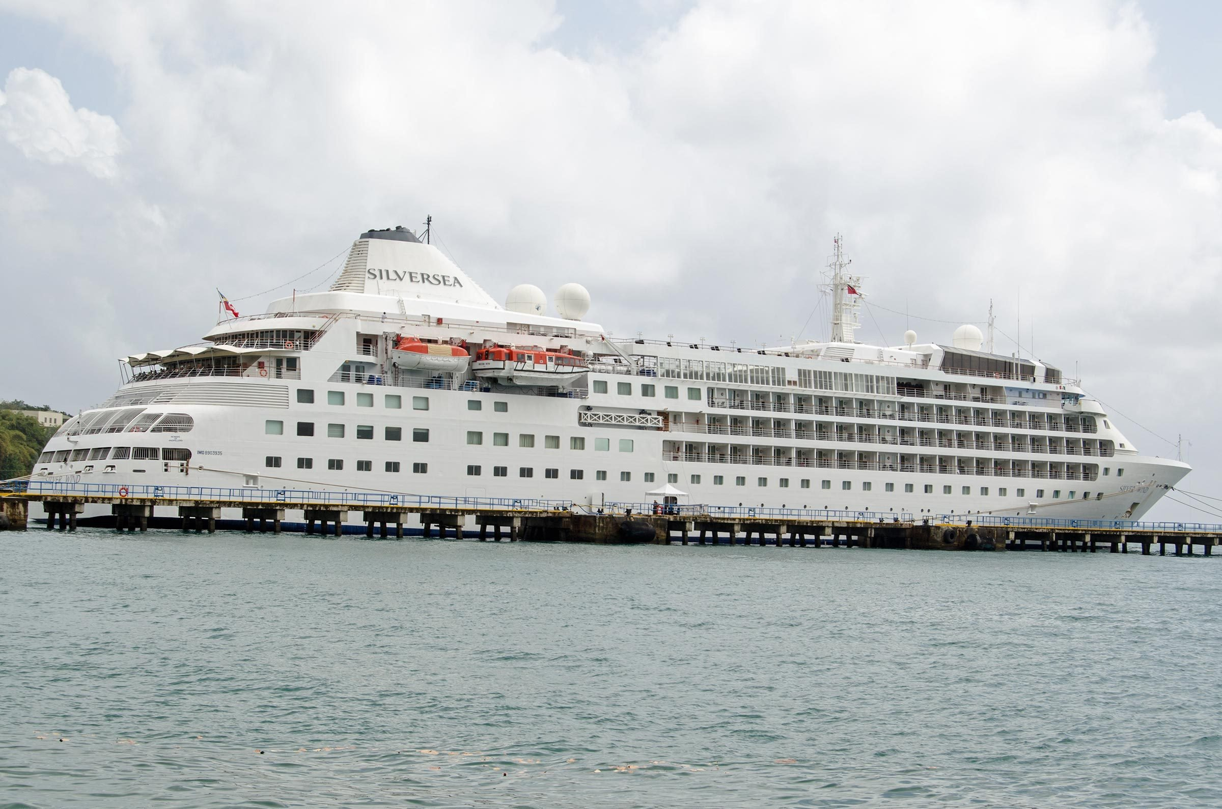 SCARBOROUGH, TRINIDAD AND TOBAGO - JANUARY 11, 2019: The cruise ship Silver Wind docked in the deep water harbour of Scarborough on the island of Tobago. Part of the Silversea line of ships.