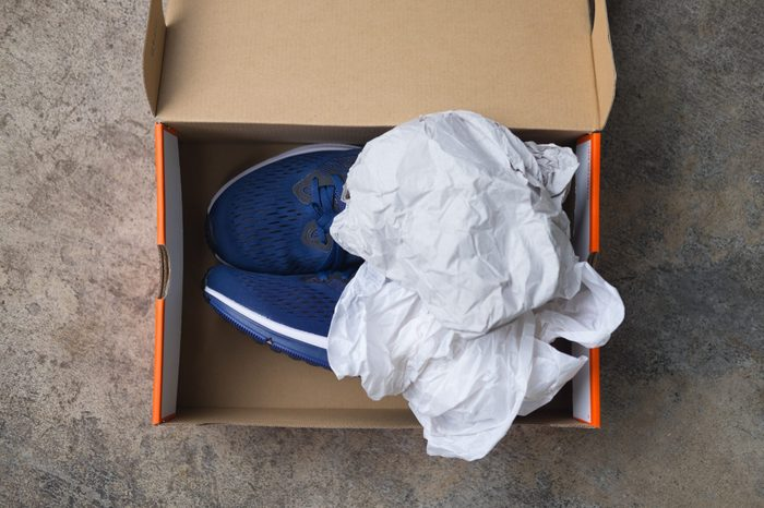 New blue sport shoes in paper box