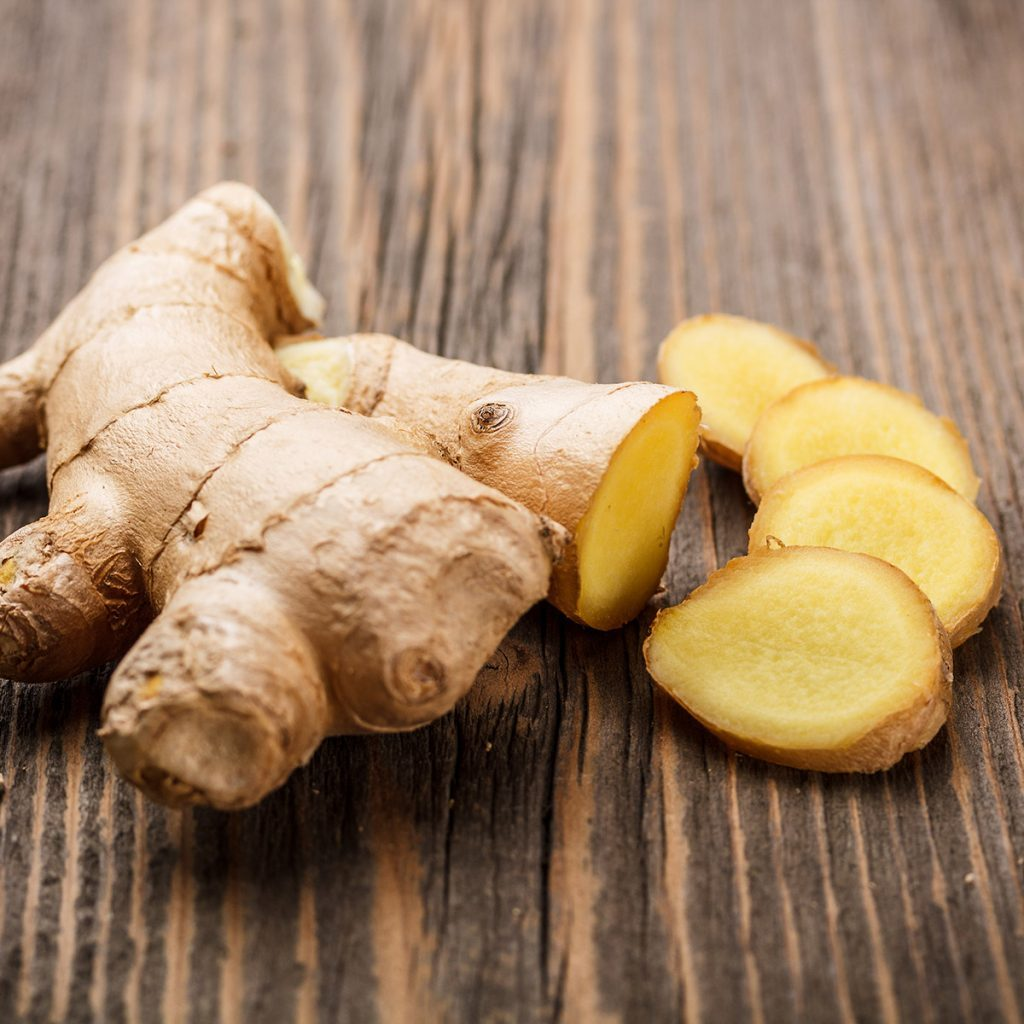 Ginger root sliced on wooden table; Shutterstock ID 127542449